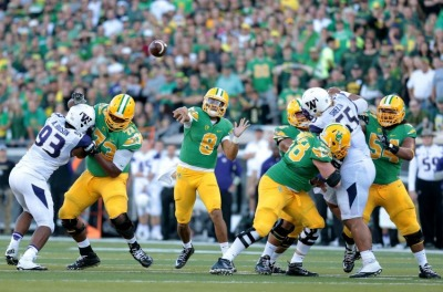 marcus-mariota-andrew-hudson-ncaa-football-washington-oregon-850x560