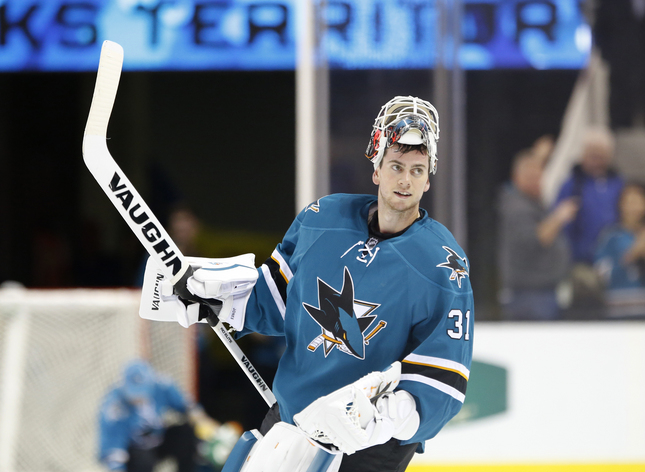 The San Jose Sharks goalie Martin Jones (31) celebrates a 2-1 win against Vancouver Canucks' in the third period of an exhibition game at SAP Center in San Jose, Calif., on Tuesday, Sept. 29, 2015. (Josie Lepe/Bay Area News Group)