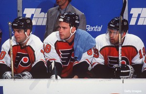 "23 APR 1995: PHILADELPHIA FLYERS ""LEGION OF DOOM"" LINE, LEFT TO RIGHT: JOHN LECLAIR, ERIC LINDROS, MIKAEL RENBERG, ON THE BENCH DURING A 4-2 LOSS TO THE BUFFALO SABRES AT THE MEMORIAL AUDITORIUM IN BUFFALO, NEW YORK. Mandatory Credit: Harry Scull/ALLSPOR"