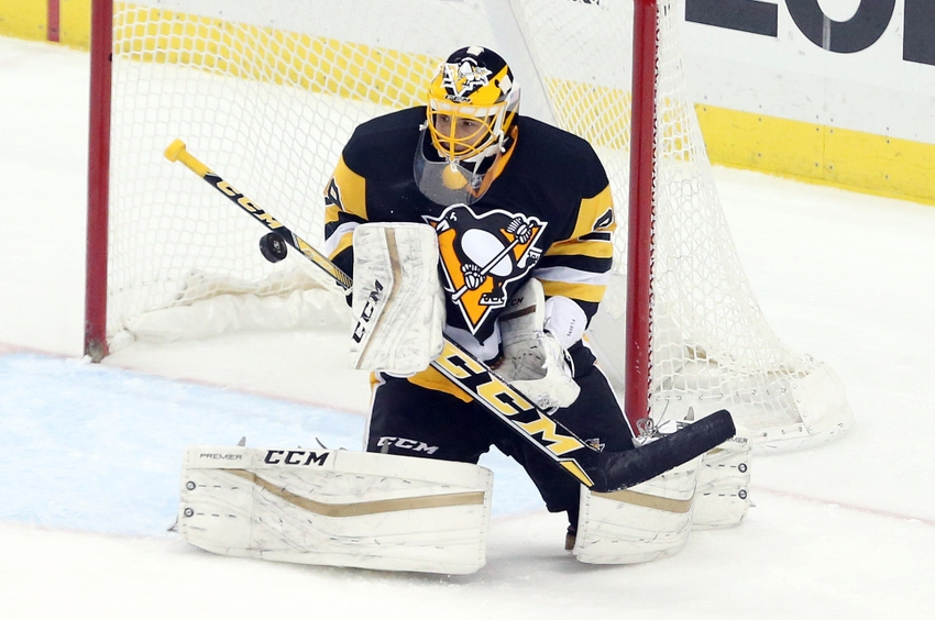 Jan 2, 2016; Pittsburgh, PA, USA; Pittsburgh Penguins goalie Marc-Andre Fleury (29) makes a save against the New York Islanders during the second period at the CONSOL Energy Center. Mandatory Credit: Charles LeClaire-USA TODAY Sports