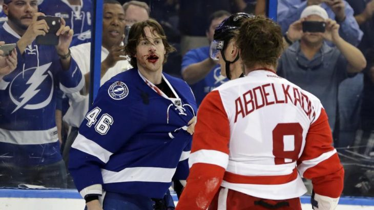 Tampa Bay Lightning right wing Michael Blunden (46) is bloodied after a fight with Detroit Red Wings left wing Justin Abdelkader (8) during the third period of Game 2 in a first-round NHL hockey Stanley Cup playoff series Friday, April 15, 2016, in Tampa, Fla. The Lightning won 5-2. (AP Photo/Chris O'Meara)