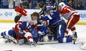 TAMPA, FL - APRIL 15:  Members of the Detroit Red Wings and Tampa Bay Lightning fight during the third  period in Game Two of the Eastern Conference Quarterfinals during the 2016 NHL Stanley Cup Playoffs at Amalie Arena on April 15, 2016 in Tampa, Florida. (Photo by Mike Carlson/Getty Images) ORG XMIT: 629093049 ORIG FILE ID: 521454432