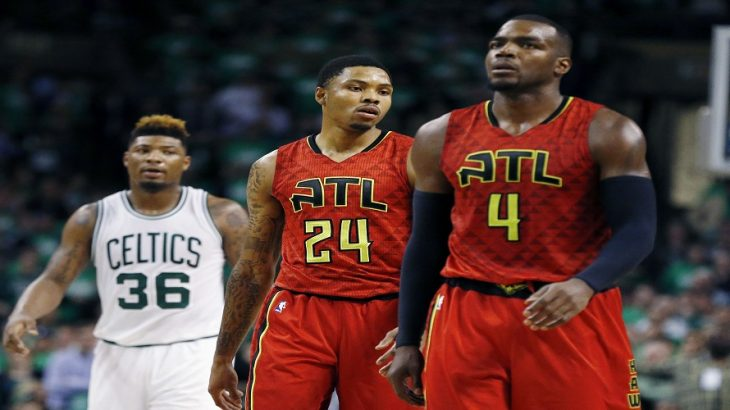 Atlanta Hawks' Kent Bazemore (24) and Paul Millsap (4) walk up court in front of Boston Celtics' Marcus Smart (36) in overtime during game 4 of a first-round NBA basketball playoff series in Boston, Sunday, April, 24, 2016. The Celtics won 104-95. (AP Photo/Michael Dwyer)