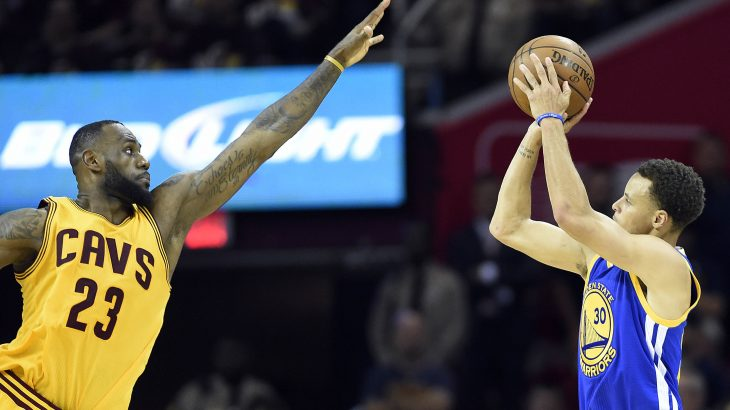 Jun 9, 2015; Cleveland, OH, USA; Golden State Warriors guard Stephen Curry (30) shoots the ball over Cleveland Cavaliers forward LeBron James (23) during the fourth quarter in game three of the NBA Finals at Quicken Loans Arena. Mandatory Credit: Bob Donnan-USA TODAY Sports - RTX1FVBH