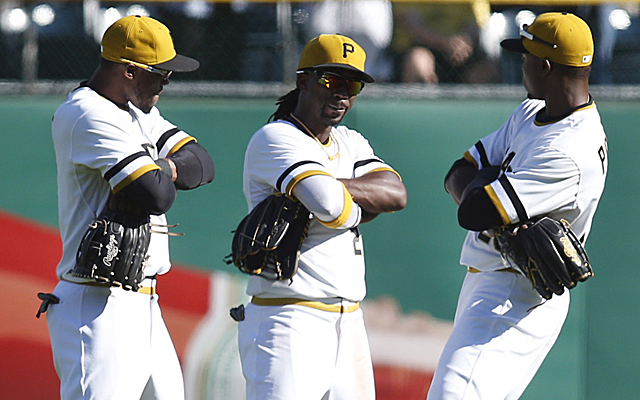 Sep 14, 2014; Pittsburgh, PA, USA; Pittsburgh Pirates left fielder Starling Marte (left) and center fielder Andrew McCutchen (middle) and right fielder Gregory Polanco (right) celebrate after defeating the Chicago Cubs at PNC Park. The Pirates won 7-3. Mandatory Credit: Charles LeClaire-USA TODAY Sports