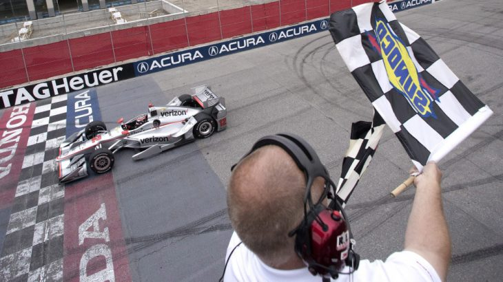 Will Power, of Australia, takes the checkered flag as he crosses the finish line to win the IndyCar auto race in Toronto on Sunday, July 17, 2016. (Mark Blinch /The Canadian Press via AP) ORG XMIT: MDB503