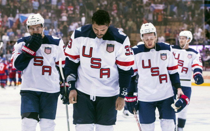 Team USA's Dustin Byfuglien, centre, Matt Niskanen, left, and Patrick Kane, right, leave the ice after their team lost to Team Czech Republic in World Cup of Hockey action in Toronto, Thursday, Sept. 22, 2016. (Mark Blinch/The Canadian Press via AP) ORG XMIT: MDB113