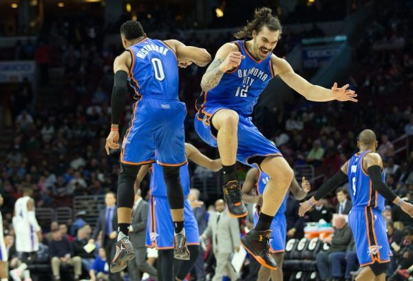 Mar 18, 2016; Philadelphia, PA, USA; Oklahoma City Thunder guard Russell Westbrook (0) celebrates with center Steven Adams (12) after his three pointer against the Philadelphia 76ers during the fourth quarter at Wells Fargo Center. The Oklahoma City Thunder won 111-97.Mandatory Credit: Bill Streicher-USA TODAY Sports