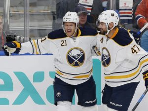 Oct 16, 2016; Edmonton, Alberta, CAN; Buffalo Sabres forward Kyle Okposo (21) celebrates a first period gaol against the Edmonton Oilers at Rogers Place. Mandatory Credit: Perry Nelson-USA TODAY Sports